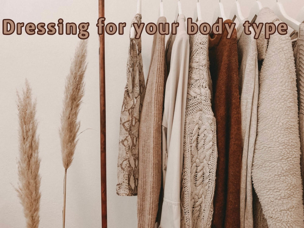 rail of clothes with writing 'dressing for your body type